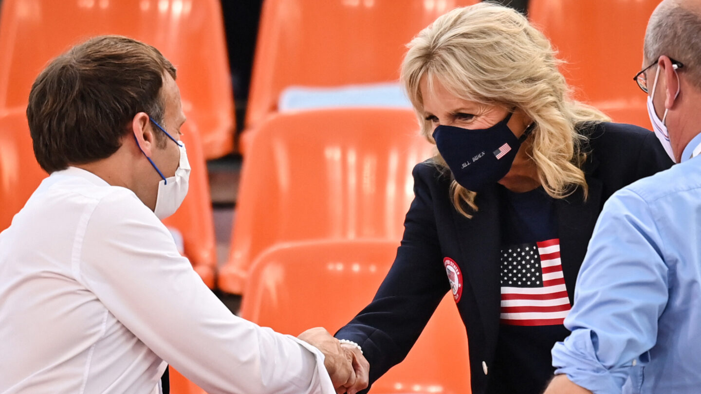 <i>Andrej Isakovic/AFP/Getty Images</i><br/>French President Emmanuel Macron and First Lady Jill Biden shake hands ahead of the women's first round 3x3 basketball match between the US and France.