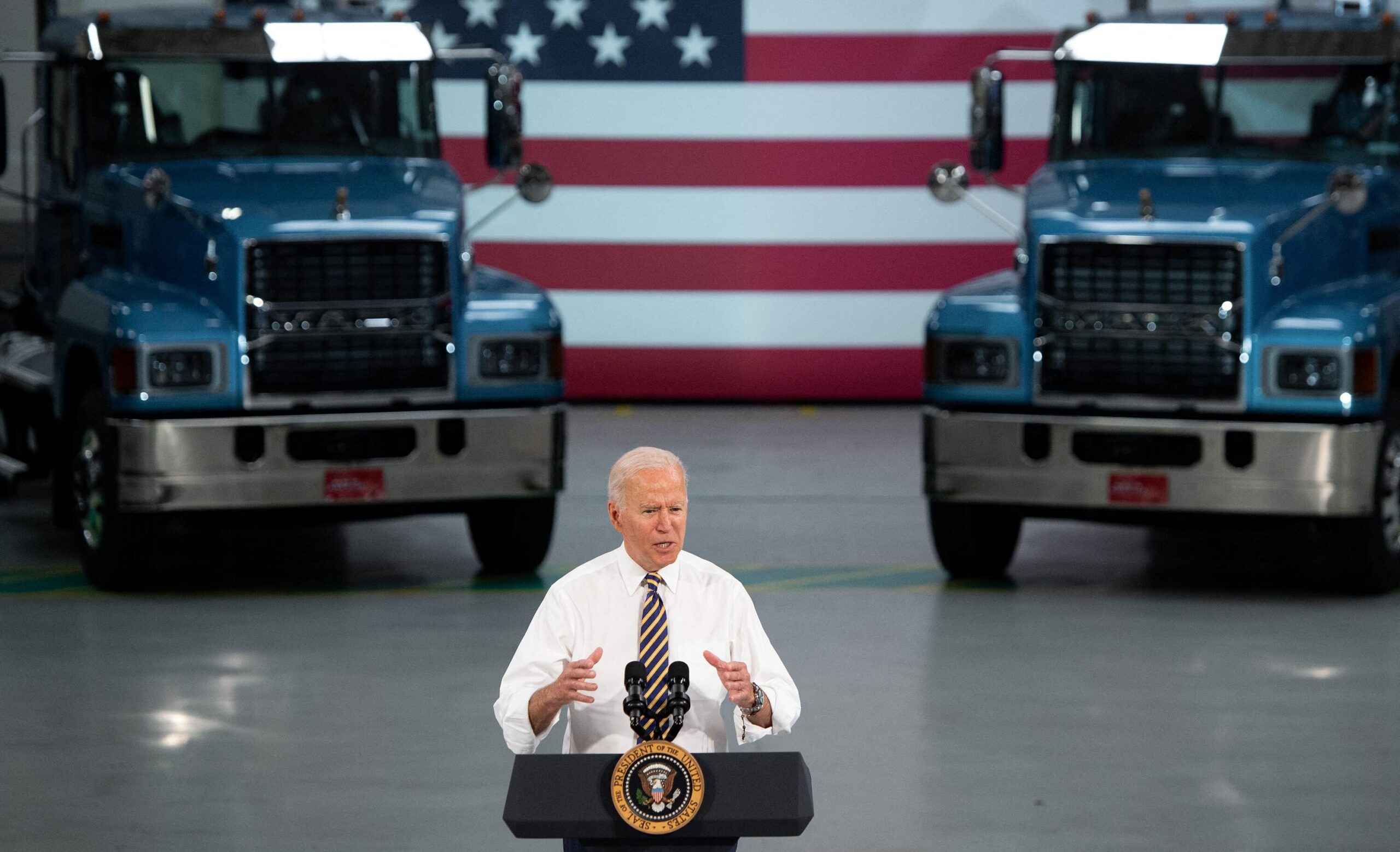 <i>SAUL LOEB/AFP/Getty Images</i><br/>US President Joe Biden speaks about American manufacturing and the American workforce after touring the Mack Trucks Lehigh Valley Operations Manufacturing Facility in Macungie