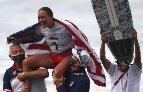 US's Carissa Moore celebrates after winning the women's Surfing gold medal final at the Tsurigasaki Surfing Beach