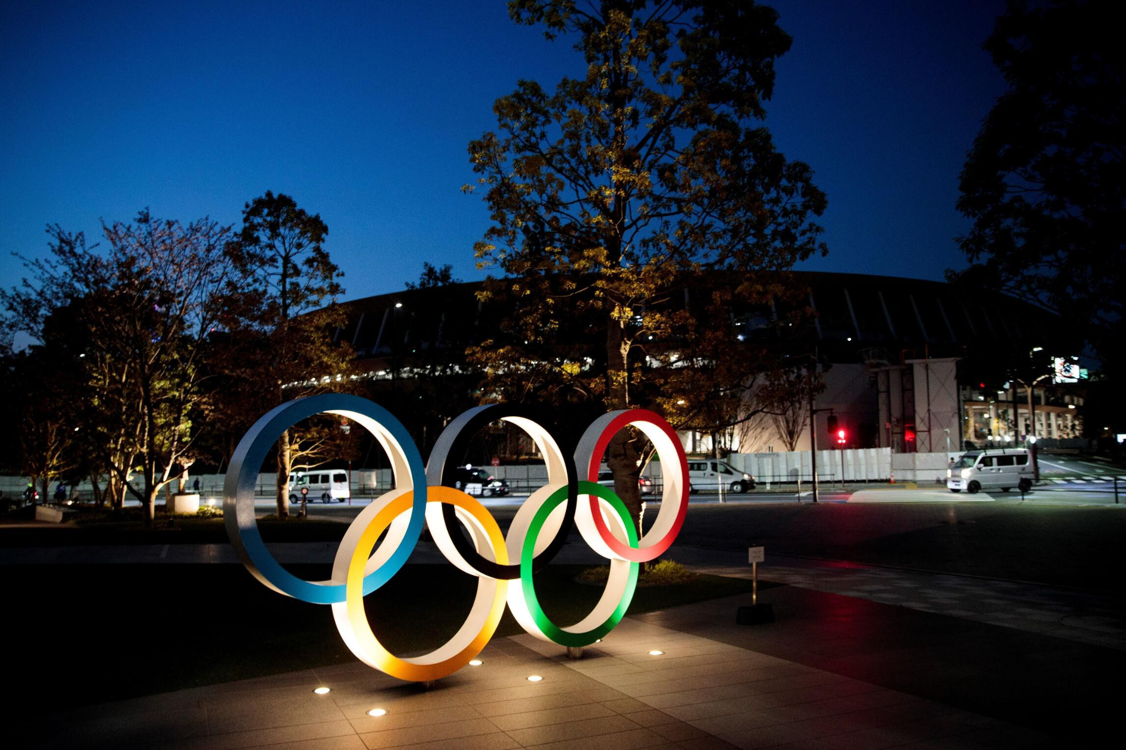 <i>BEHROUZ MEHRI/AFP/AFP via Getty Images</i><br/>The Olympic rings are displayed outside the National Stadium
