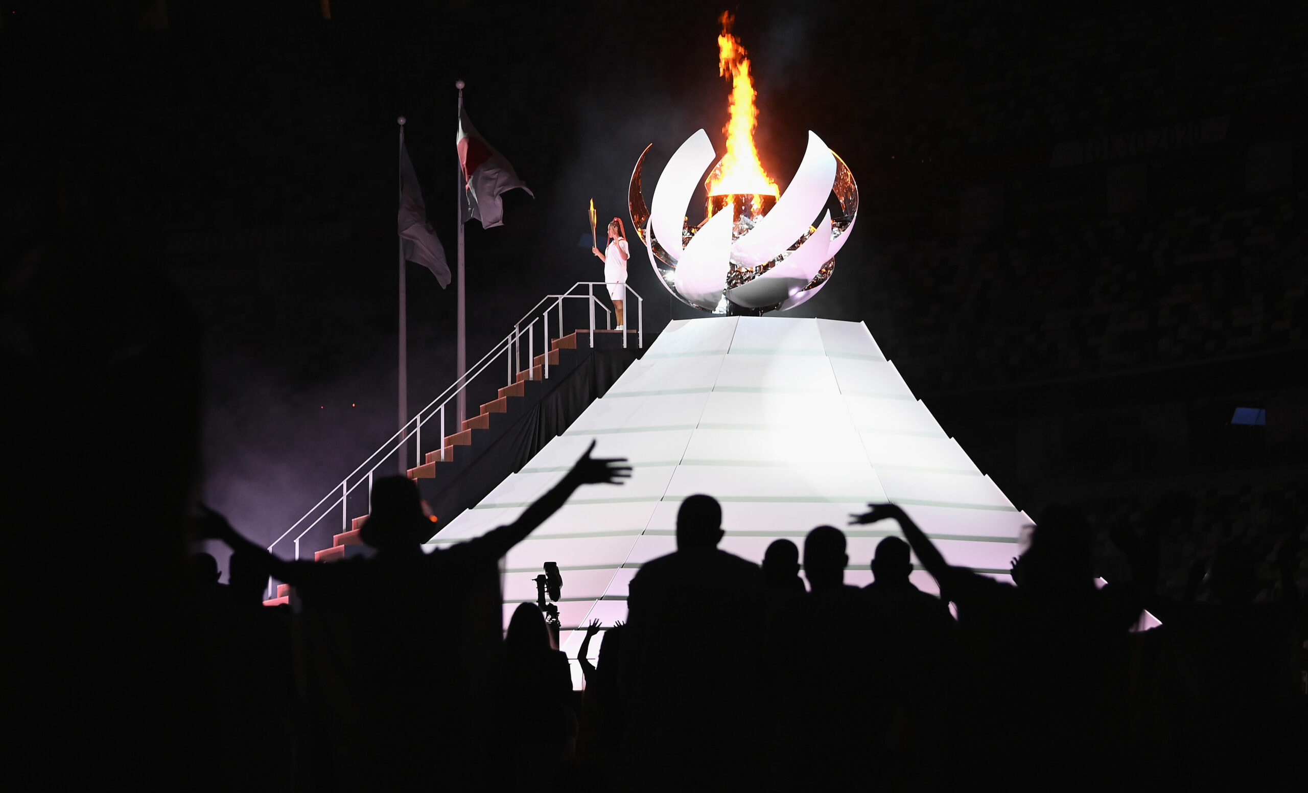 <i>Matthias Hangst/Getty Images</i><br/>Naomi Osaka of Team Japan lights the Olympic cauldron with the Olympic torch during the opening ceremony of the Tokyo 2020 Olympic Games on Friday