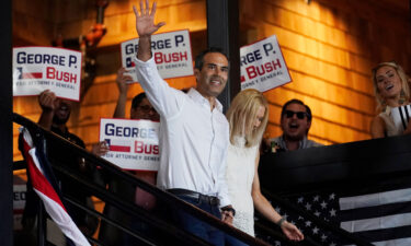 Texas Land Commissioner George P. Bush arrives for a kick-off rally with his wife Amanda to announced he will run for Texas Attorney General