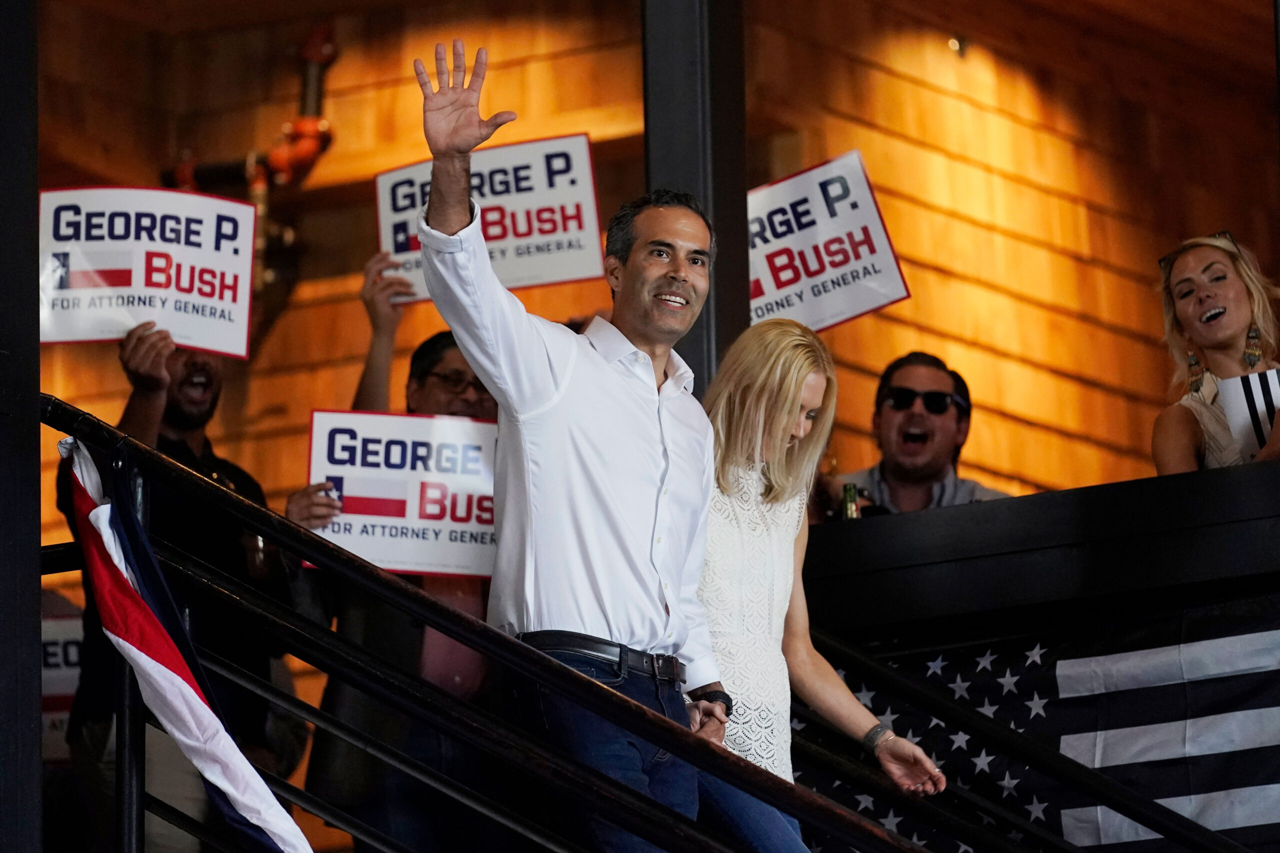 <i>Eric Gay/AP</i><br/>Texas Land Commissioner George P. Bush arrives for a kick-off rally with his wife Amanda to announced he will run for Texas Attorney General