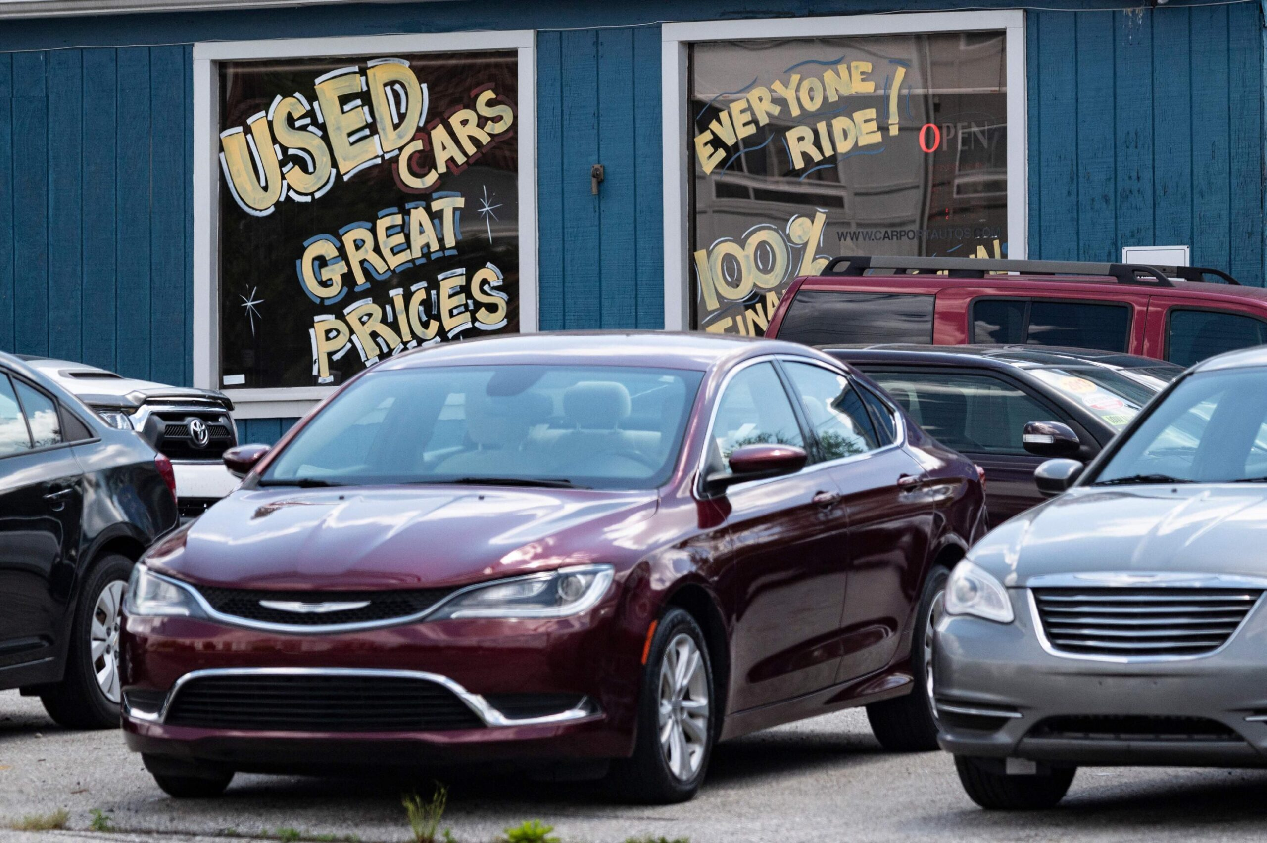 <i>Jim Watson/AFP/Getty Images</i><br/>A used car dealership is seen in Laurel