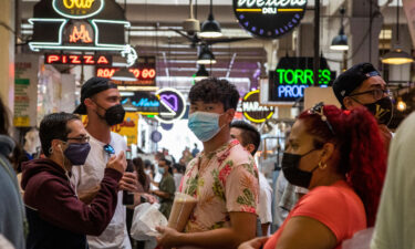 Visitors to the Grand Central Market are mostly masked on July 27