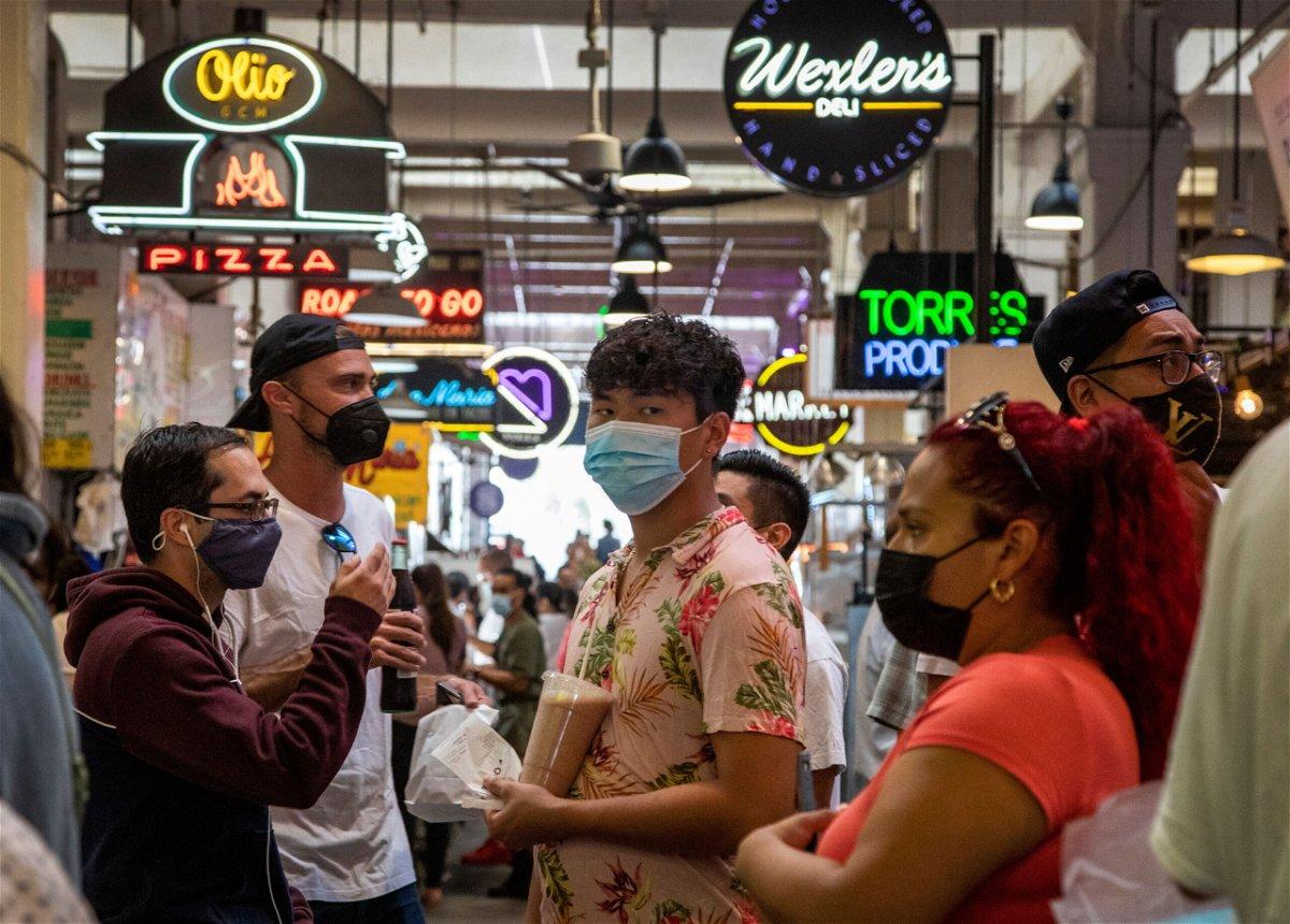 <i>Brian van der Brug/Los Angeles Times/Getty Images</i><br/>Visitors to the Grand Central Market are mostly masked on July 27