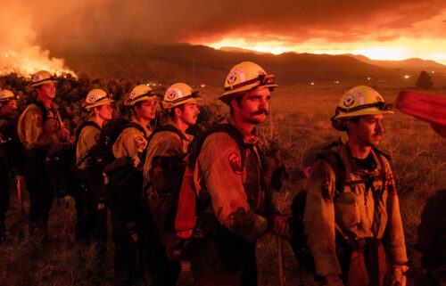 Firefighters from Cal Fire's Placerville station monitor the Sugar Fire