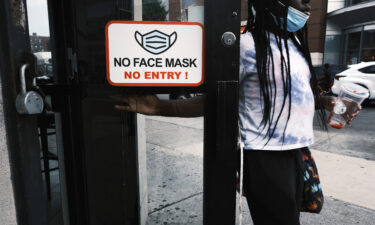 """The US Centers for Disease Control and Prevention issued updated guidance saying that people in areas of """"substantial"""" and """"high"""" transmission should wear a face mask indoors."""
