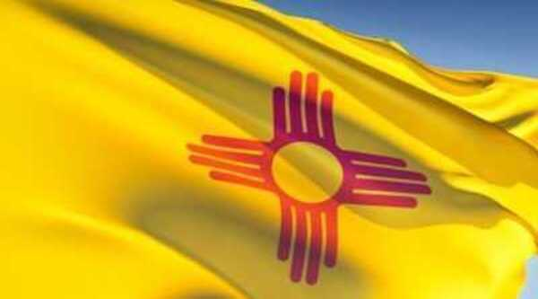 The state of New Mexico's flag flies in a breeze..