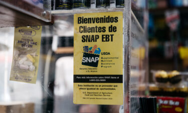 A sign alerting customers about SNAP food stamps benefits is displayed in a Brooklyn grocery store in New York City.