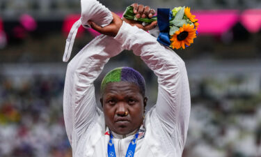 The probe into US athlete Raven Saunders' X gesture at the Olympics has been suspended after her mother's death.