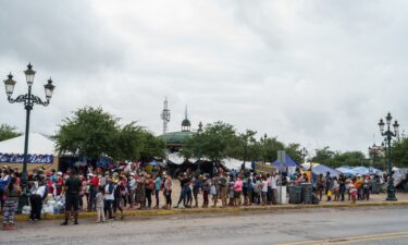 A Federal appeals court Thursday ordered the Biden administration to reinstate former President Donald Trump's 'remain in Mexico' policy.  Migrants here line up for food in a camp in Reynosa
