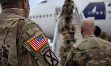 The Pentagon is mandating that US military service members get fully vaccinated against Covid-19 immediately. U.S. Army soldiers here return home from Afghanistan on December 10