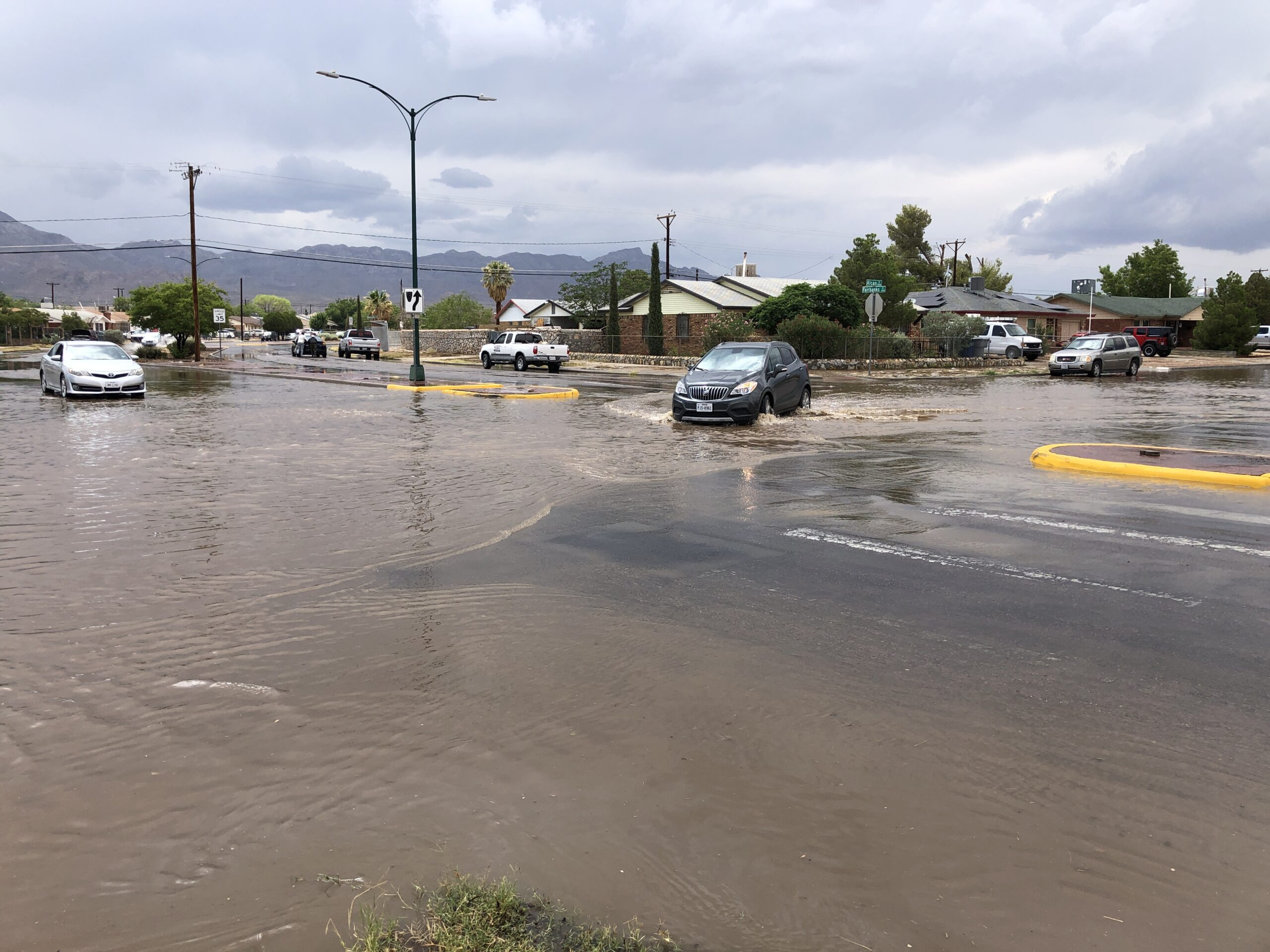 Cars get overwhlemed by street flooding at an El Paso intersection following heavy rain.