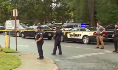 Police and other first responders are seen at Mount Tabor High School in Winston-Salem