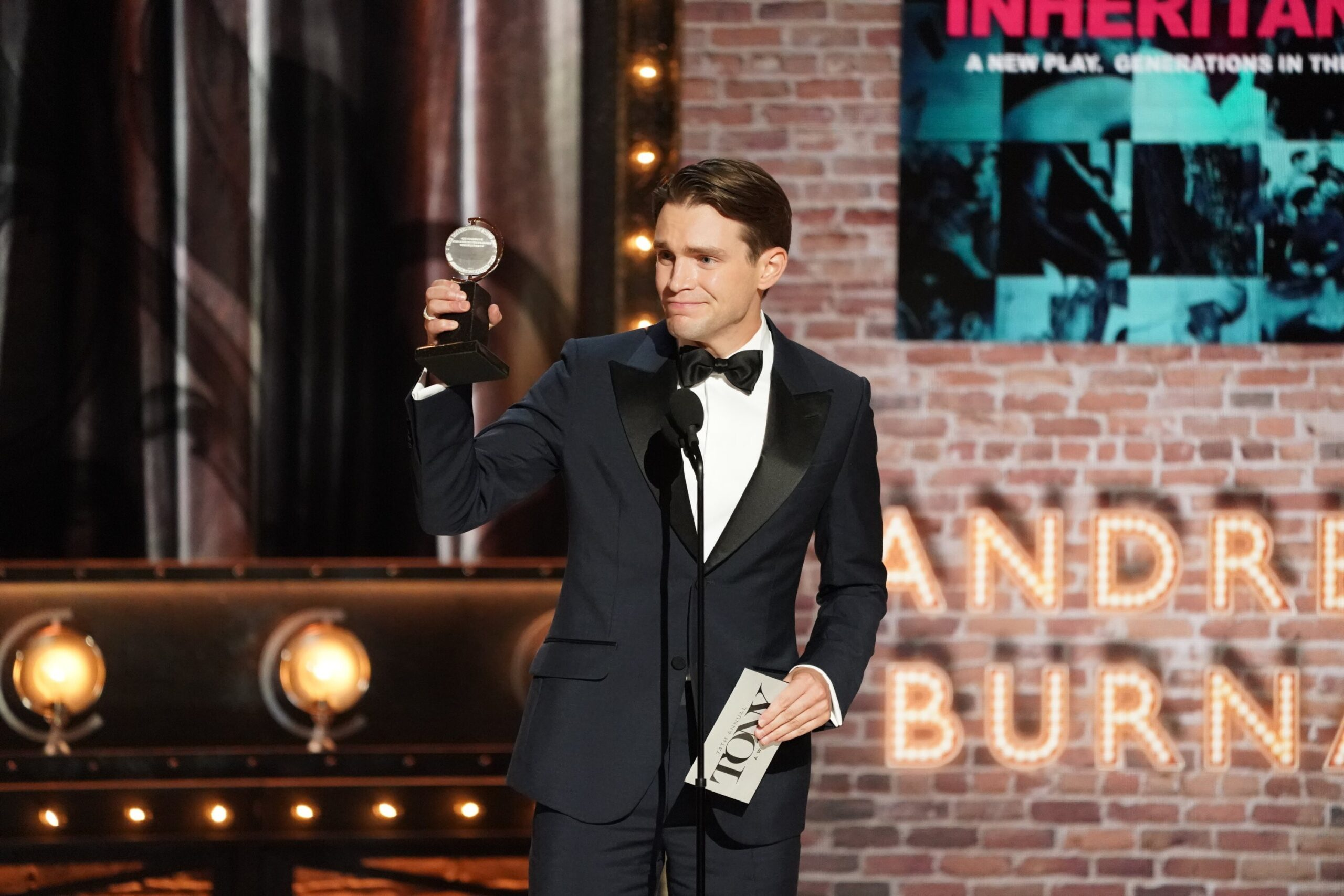 <i>Mary Kouw/CBS</i><br/>Andrew Burnap receives the award for Best Performance by an Actor in a Leading Role in a Play during Sunday's Tony Awards.