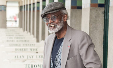 Melvin Van Peebles poses next to the beach closet dedicated to him on the Promenade des Planches in 2012 in Deauville