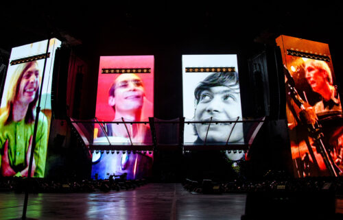 A video tribute to Charlie Watts plays before the Rolling Stones perform in St. Louis