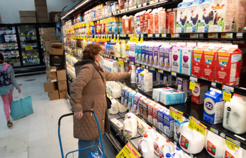The dairy shelf is crowded
