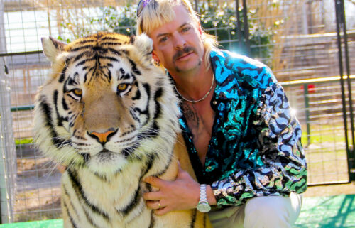 "Joseph Maldonado-Passage aka Joe Exotic and one of his cats in the Netflix docuseries ""Tiger King: Murder"