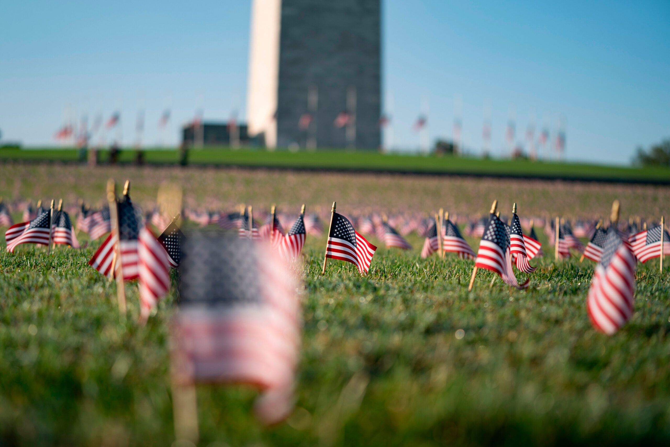 <i>Alex Edelman/AFP/Getty Images</i><br/>A memorial for people who have died as a result of of Covid-19 is seen on the National Mall on September 22