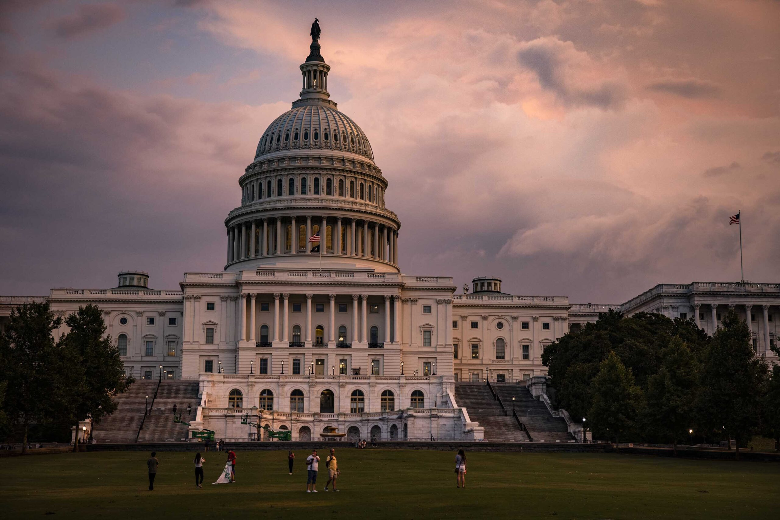<i>Samuel Corum/Getty Images</i><br/>The U.S. Capitol Building is seen as the sun sets on it.