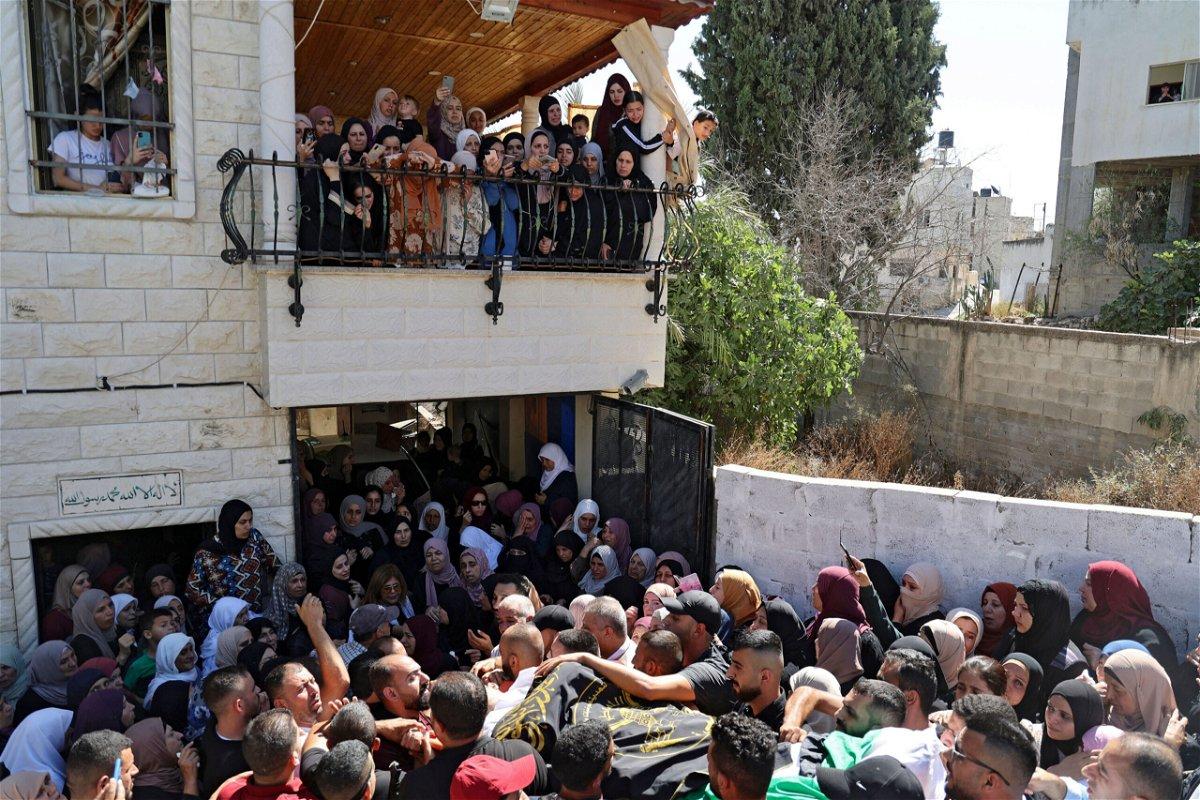<i>Jaafar Ashtiyeh/AFP/Getty Images</i><br/>Mourners carry the body of Osama Sobh