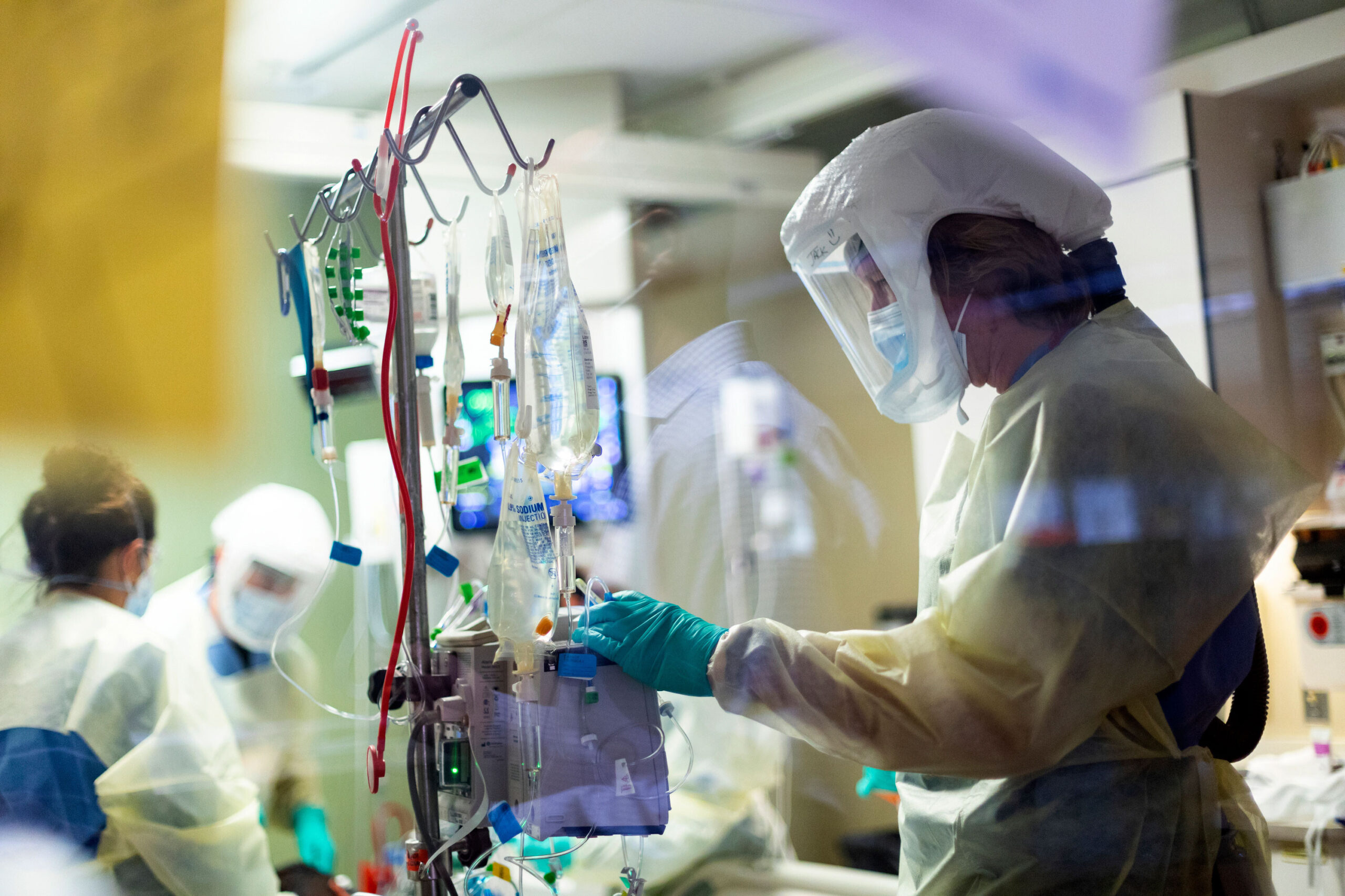 <i>Kyle Green/AP</i><br/>Jack Kingsley R.N. attends to a Covid-19 patient in the Medical Intensive care unit (MICU) at St. Luke's Boise Medical Center in Boise
