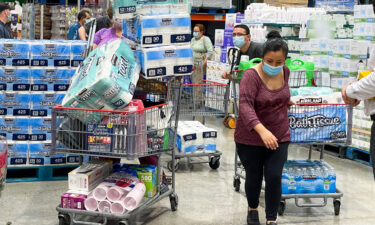 People buy toilet papers and paper towels at a Costco Wholesale store as panic buying following the coronavirus disease outbreak in Alhambra
