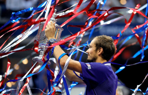 Medvedev celebrates with the US Open trophy.