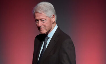 President Joe Biden will speak with former President Bill Clinton on Friday after Clinton was hospitalized for an infection. Clinton is shown here on September 26
