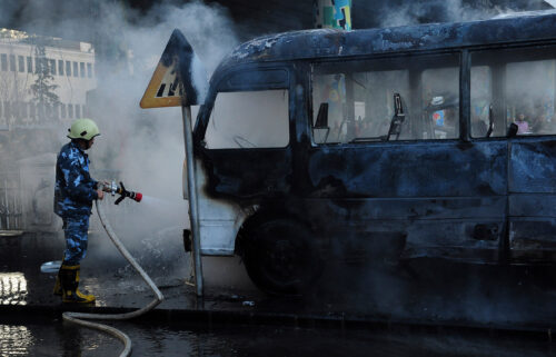 Four children were among at least 10 people killed in Syrian regime strikes in the northwestern rebel-held area of Idlib on October 20 a rescue group said. A firefighter is seen extinguishing a military bus.