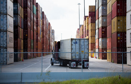 An eighteen-wheeler is seen entering one of the main shipping container corridors at The Port of Houston on October 12th