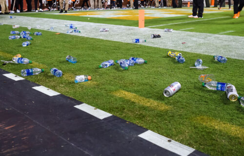 Debris is seen on the field after fans threw objects onto the field during the game between the Tennessee Volunteers and Mississippi Rebels at Neyland Stadium.