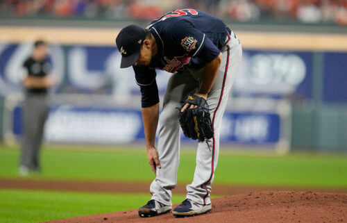 Atlanta Braves starting pitcher Charlie Morton rubs his leg before leaving the game during the third inning of Game 1 of the World Series on Tuesday.