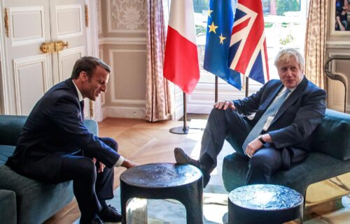 France has detained a British fishing vessel and announced it will close nearly all of its ports to trawlers from the UK. French President Emmanuel Macron and Britain's Prime Minister Boris Johnson are seen here in 2019.