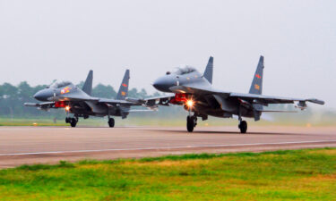 In this undated file photo two Chinese SU-30 fighter jets take off from an unspecified location to fly a patrol over the South China Sea. China flew more than 30 military planes