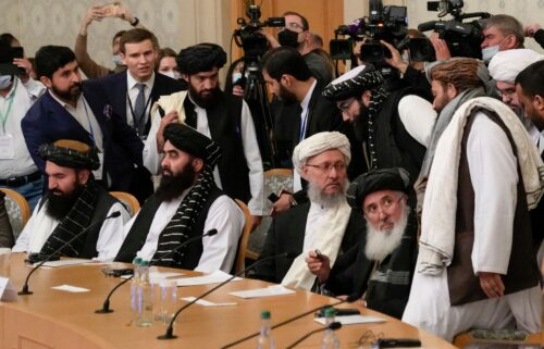 Deputy Prime Minister of Afghanistan's interim government Abdul Salam Hanafi (center) and members of the Taliban delegation attend an international conference on Afghanistan in Moscow on October 20.